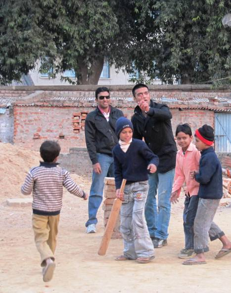 Playing cricket with local kids