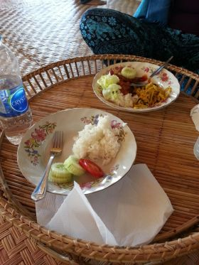 My lunch, plain white rice , cucumber and tomato.